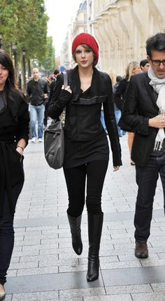 Taylor Swift's Red Beanie with black tights, boots and biker jacket.  Outfit details: http://wwtaylorw.com/87/