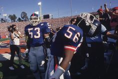 Harry Carson watches teammate Lawrence Taylor howl on the sidelines during Super Bowl XXI between the New York Giants and Denver Broncos on Jan. 25, 1987 at the Rose Bowl in Pasadena, Calif. Arguably...