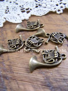 Set of 5 // Antiqued Bronze French Horn Charms by BLBasics on Etsy, $2.50