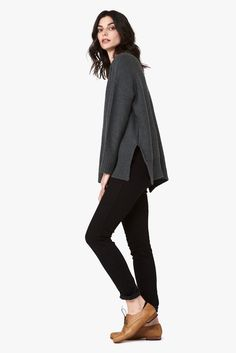 Super soft crew neck sweater with relaxed, oversized fit by Knot Sisters. Includes slits at the side seams and the front is slightly longer then the back. A perfect throw on over your favorite dress to head out into the day!