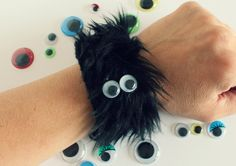 Furry Monster Googly Eye Bracelets from Make & Takes (This would be a fun birthday craft if you pre-sewed the velcro on for kids instead of using safety pins)