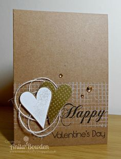 Kraft paper and white jute twine give a simple, rustic look to this handmade valentine's card.  The hearts have been popped up for some dimension.