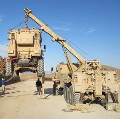Navistar Defense MaxxPro Recovery Vehcile with Performance Kit Overhead Crane Operator Training OSHA & ANSI Compliant www. Big Rig Trucks, Tow Truck, Cool Trucks, Army Vehicles, Armored Vehicles, Armored Truck, Expedition Vehicle, Heavy Truck, Military Weapons