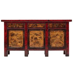 Stunning Red Lacquer  Antique Chinese Sideboard. This gorgeuous piece originated from Gansu Province and is around a hundred years old. The detailed paintings of mountain landscapes on the doors contrast beautifully with the surrounding red lacquer frames.