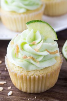 Coconut cupcakes with lime buttercream frosting have a triple dose of coconut & a soft, buttery texture. Topped with fluffy lime frosting & toasted coconut