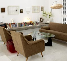 vintage looking couch and lounge chairs paired with Noguchi coffee table