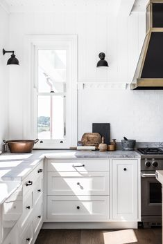 Home Decor Kitchen White Modern Farmhouse Kitchen with shiplap and black sconces.Home Decor Kitchen White Modern Farmhouse Kitchen with shiplap and black sconces Home Decor Kitchen, Kitchen Dining, Kitchen Cabinets, Kitchen Ideas, Pottery Barn Kitchen, Decorating Kitchen, Kitchen Cupboard, Black Cabinets, Apartment Kitchen
