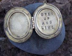 words i am reminding myself of today :: open up and live . a (whispered) soul mantra locket.