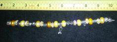 $25.00  Awareness Ribbon Bracelet Yellow Gold Cancer