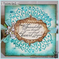 Tammy Tutterow | True Friendship Card-Tutorial  For my project I dug way into the Tim Holtz stamp archives and pulled out stamp set #18.  It is an oldie but such a goodie!  The peacock feathers in this set has been a long time favorite of mine.  I hadn't used it in a long time  so I thought it would be fun to use it along with Peacock Feather Distress Ink.  I stamped, embossed, blended, and spritzed the ink to get different colorations from the same ink color.