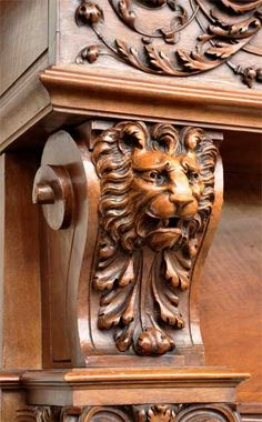 Antique walnut fireplace with grotesques and lions heads decoration