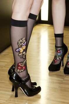 dolce and gabbana (fall 2012) I like the ones pushed down with the flowers on the front :)