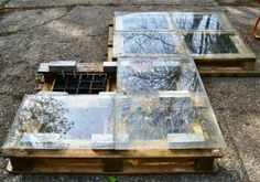 Pallets as seed starters - fill with plastic pots  soil, use some bricks to raise the glass covers a bit...an old slider door or some sort of window on top.
