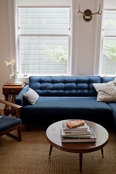 Someday I will have a navy blue couch!!!  unexpected guests: kate davison. / sfgirlbybay