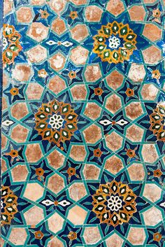 Tile work, Gür-i Amir, Samarkand, Uzbekistan. First evening in Samarkand, when I was hours away from coming down with a case of Tamerlane's Revenge, we walked around the corner from our hotel to the mausoleum of the great and powerful Amir Temür, the west's Tamurlane.  I won't lie. As mausoleums go … it's pretty awesome. Photo by Christopher Rose.