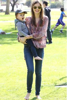 Miranda Kerr - in skinny jeans and a printed blouse - enjoyed a day in the park with son Flynn.