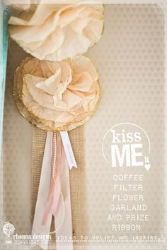 diy valentine craft idea no. 5...glammed coffee filter flower garlands and prize ribbon.