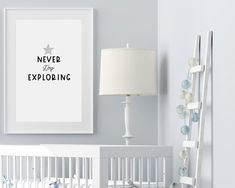 """Nursery wall art and nursery ideas from Sunny and Pretty. Space nursery prints that will complete your decor. The """"Never stop exploring"""" quote is perfect for kid's room decor or playroom wall art. Nursery art to complete your nursery decor project. Our nursery wall art is made with love and is designed to reflect your nursery wall decor style and encourage your little one's imagination.🖤 Get excited about decorating for your little one! #sunnyandpretty Nursery Artwork, Nursery Wall Decor, Baby Room Decor, Nursery Themes, Nursery Prints, Nursery Ideas, Playroom Ideas, Outer Space Nursery, Space Themed Nursery"""