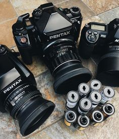 This terrific trio of cameras belong to and consist of a Pentax Pentax and a Nikon Topping everything off is a selection of and Ilford Pentax Camera, Camera Nikon, Camera Gear, Film Camera, Old Cameras, Vintage Cameras, Camera Hand Strap, Nikon F100, Photo Lens