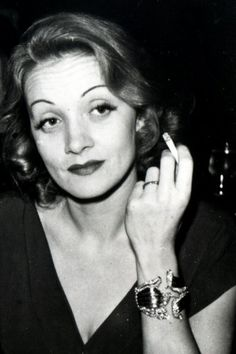 Marlene Dietrich wearing her Lily bracelet designed by Fulco di Verdura for Paul Flato