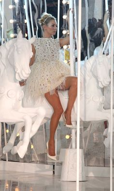 Kate Moss Rides The Louis Vuitton Carousel At The SS12 Collection Show At Paris Fashion Week, 2011