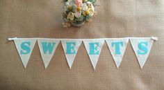 A personal favorite from my Etsy shop https://www.etsy.com/listing/241279665/sweets-wedding-banner-colored-burlap