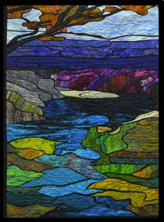 """""""Tributary"""" art quilt by Phyllis Cullen. Bold shape outlines, looks like a glass window"""