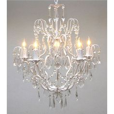 Light your dining room in style with this elegant iron chandelier with five lights. The intricately curved iron with its white finish combines with crystal accents to create an eye-catching piece that is sure to intrigue your guests.