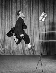 British comedian Norman Wisdom in 'London Melody' at the Empress Hall London Norman has to jump to read the music as he is too short for the music...