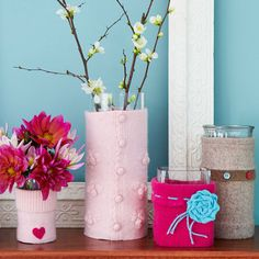 Glassware Cozies - using dollar store vases/left over florist vases and old sweaters.