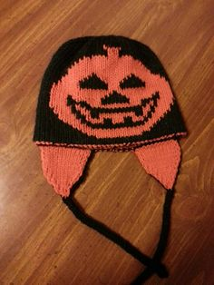 This hat is knit in a round in double knit stitch. It is knit bottom up and is reversible. It can be made with out without earflaps.