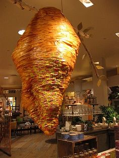 Weirdly lovely: Detail of Hive from the Denver, CO Anthropoligie store - made from Bit-o-Honey candy wrappers, jars of honey, and tissue paper.
