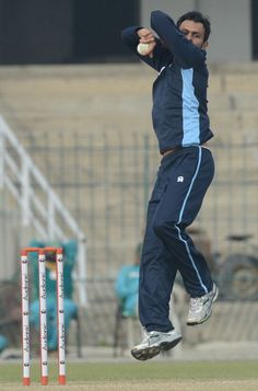 Pakistani cricketer Shoaib Malik delivers a ball during a team practice session at the Gaddafi stadium in Lahore on December 17, 2012.