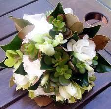 brown, green, and white bouquet: Magnolia Folage, White Lissianthius, Green Singapore, Mini Cibidium Orchids with Green Succulents