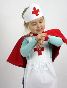 Deluxe Sweetheart Nurses Set includes a super cute little red capelet.    These gorgeous nurses outfits come with a white apron and nurses