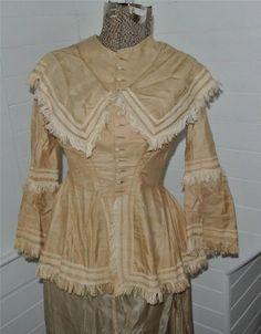 "Fantastic 19c Victorian Bodice Tan Muslin w Fringe Bell Sleeves Civil War Era | eBay seller thebigwhitebarn; tan muslin with ivory tape and fringe, covered buttons, bust: 32""; waist: 24""; length shoulder to hem: 22"""