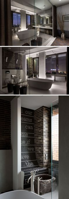 In this modern penthouse apartment, a glass wall protects the rest of the bedroom from the master bathroom and at the same time allows light from the windows to travel throughout the room. In the bathroom, there's a centrally positioned freestanding bathtub, while the shower sits behind the column and has views of the city. #MasterBathroom #BathroomDesign