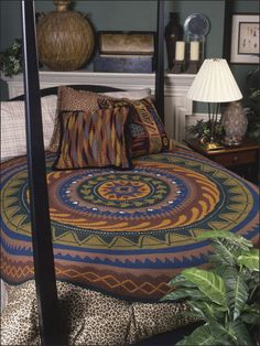 "An oldie but goodie, the Round We Go afghan from Annie's Crochet Quilt & Afghan Club is a crocheter's dream!   The southwest styling of this anything-but-ordinary creation would make it a beautiful rug too. Made with sport weight yarn.  Finished size is approximately 78"" diameter."