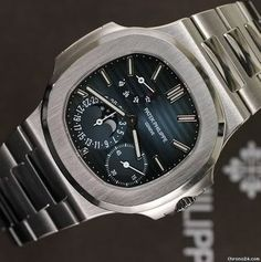 """Patek Philippe [NEW][CAN NAME] Mens Stainless Steel """"Nautilus"""" 5712/1A Blue Dial Watch at HK$259,000."""