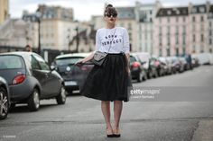 Nikita Wong (fashion blogger - meetmeinparee.com), is wearing a Bliss Tulle black skirt, a Zara  white top 'Born to be Perfect', Eram black shoes, and a Saint Laurent black bag, during a street style session, on April 6, 2016 in Paris, France.  (Photo by Edward Berthelot/Getty Images)