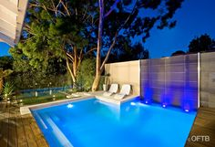 OFTB Melbourne landscaping, pool design & construction project - plunge pool, water feature wall, pool deck inc. bench, raised pool lounge, garden beds, synthetic lawn