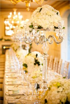 From a wedding at Graydon Hall Manor in Toronto. Love these candelabras that still have flowers on the top!