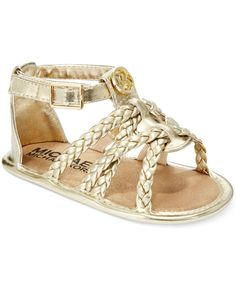 Adorable baby-chic style for sunny days...these Michael Kors feature braided…
