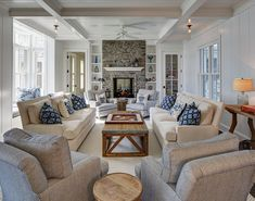 Coastal chic living room with fireplace ~ furniture placement idea