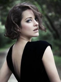 marion cotillard, in black open back dress, looking over her shoulder, with curly side-parted brunette hair, short bob hairstyles Marion Cotillard, French Actress, Famous Women, Pretty Face, Cute Hairstyles, Her Hair, Hair Inspiration, Beautiful People, Short Hair Styles