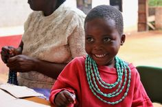 Rose, Esther's daughter, loves to help her mom bead!