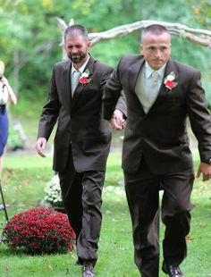Wedding photographer Delia D. Blackburn captured one of the most heartfelt wedding moments of the year when she shared a series of photo that show father of the Bride, Todd Bachman, stopping the wedding procession to grab his daughter's stepfather Todd, so he could join them in walking 'their' daughter Brittany down the aisle.