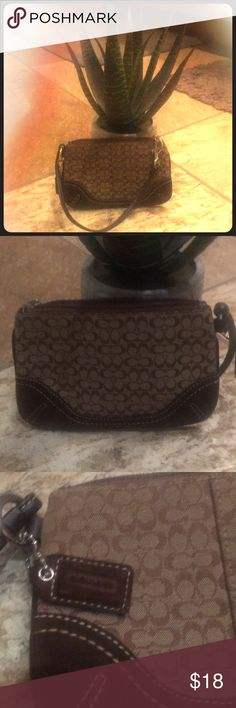 Classic Brown Coach Wristlet NWOT- classic brown Coach wristlet with suede accent and brown satin lining.  A grab-n-go wallet to carry all the necessities. Coach Bags Clutches & Wristlets