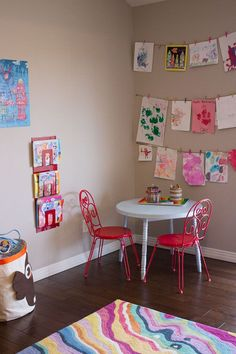 I like the Art Wall and the rack (maybe from IKEA?) for kid's coloring books.  by Design Improvised