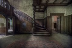 I adore the staircase in this lovely abandoned mansion.